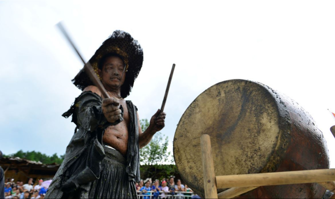 "Miao Playing Drum on ""Dog Carrying Day"""